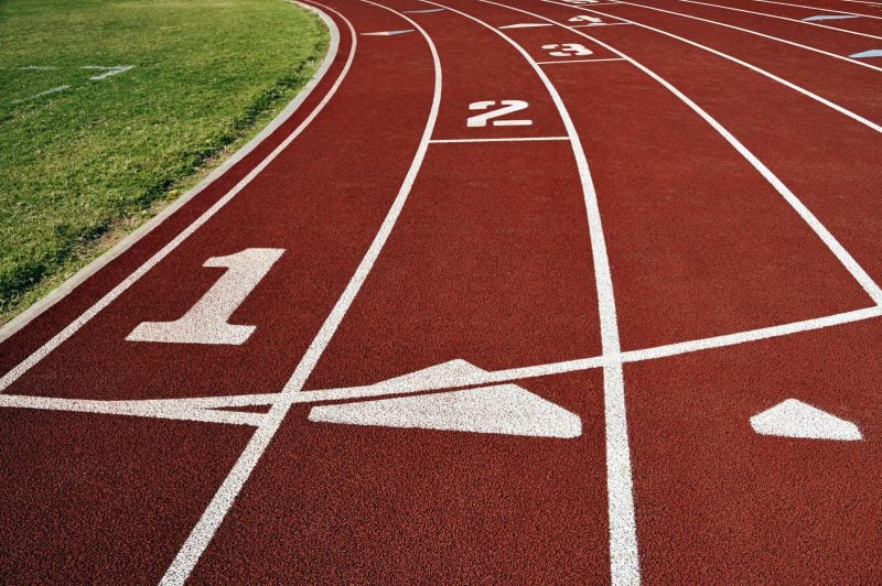Racing track with lanes marked 1, 2, 3, 4 and grass to left - Best Bible Verses For Athletes