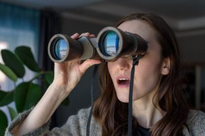 Photo of a woman with binoculars