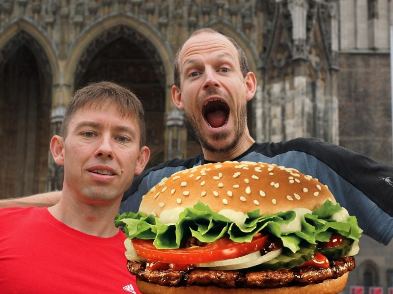two men happy at sight of burger