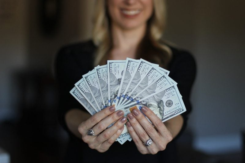 Woman holding cash money in her hands