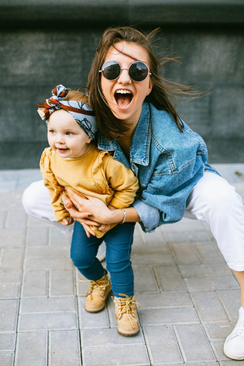 A photo of a mother and daughter laughing