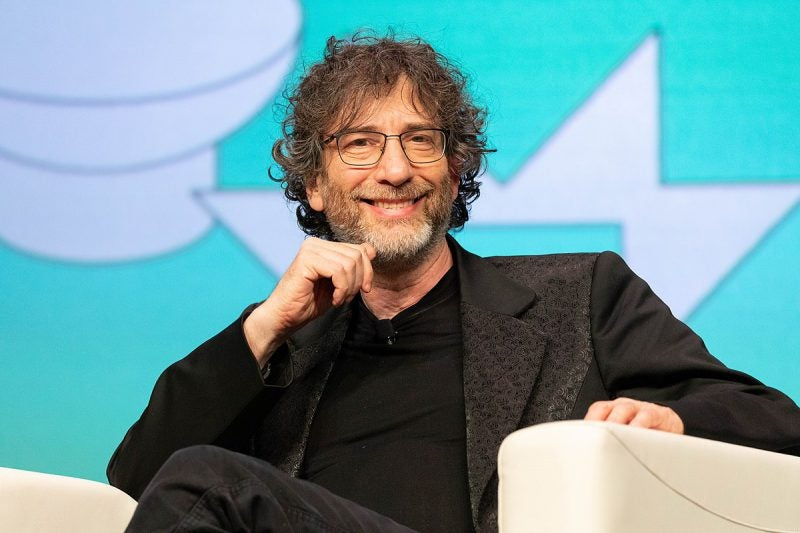 Neil Gaiman smiling on stage at sxsw